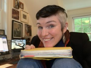 Short-haired white woman with a yellow bullet journal